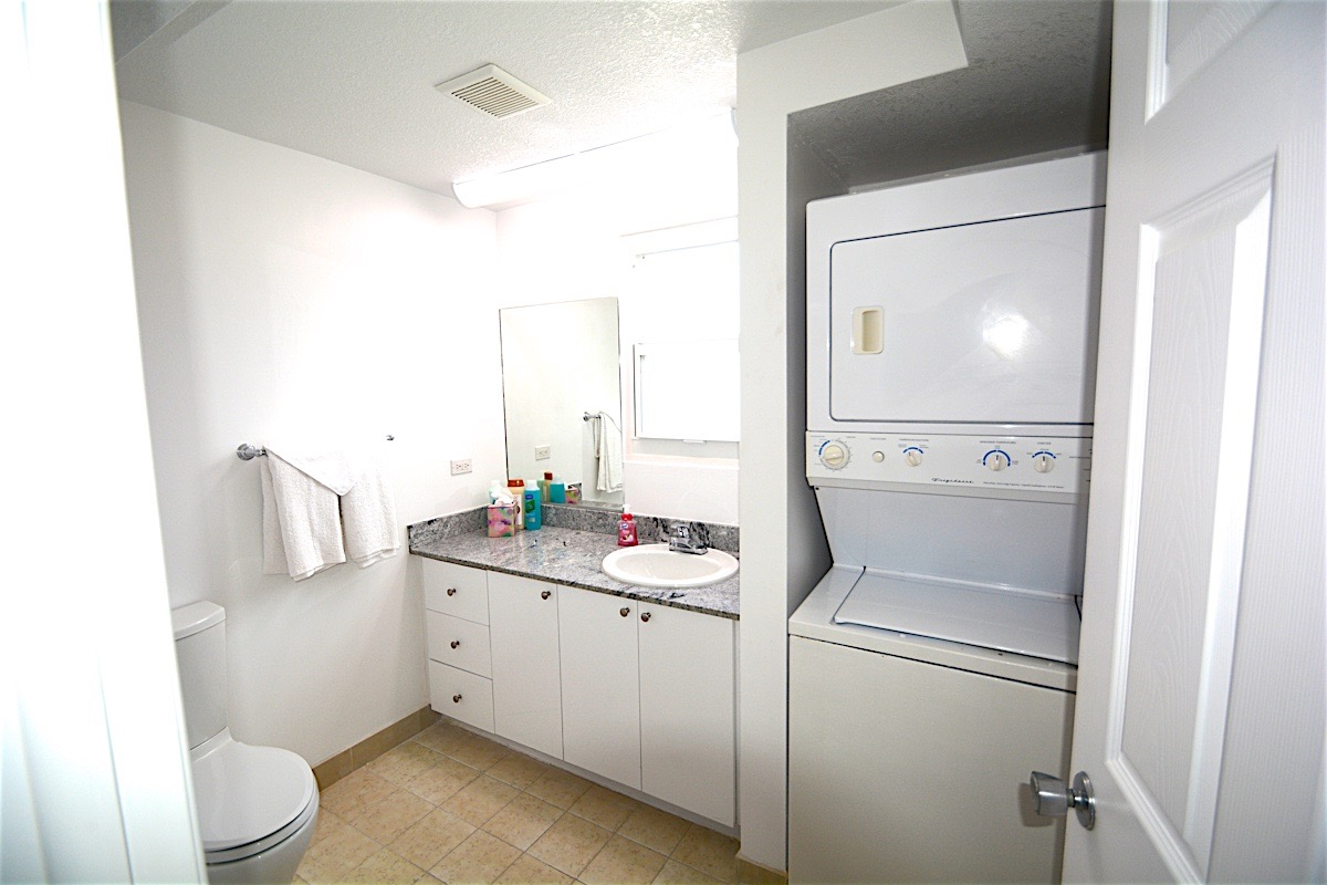 Washer and dryer in unit at the Cayman Reef Resort